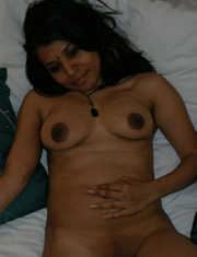 Pic gal 8. Kavya in bedroom laying naked on her bed rubbing her pussy off