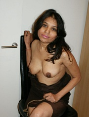 Pic gal 019. Kavya playing with her tits in lounge